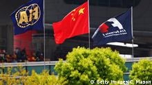 17.04.2016 *** SHANGHAI, CHINA - APRIL 17: FIA, Chinese and F1 flags fly over the paddock during the Formula One Grand Prix of China at Shanghai International Circuit on April 17, 2016 in Shanghai, China. (Photo by Clive Mason/Getty Images) © Getty Images/C. Mason