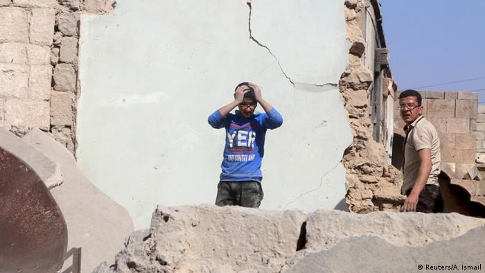 A youth reacts as he stands among the rubble after his father was killed in an airstrike on his home in the rebel-held Old Aleppo A youth reacts as he stands among the rubble after his father was killed in an airstrike on his home in the rebel-held Old Aleppo.
