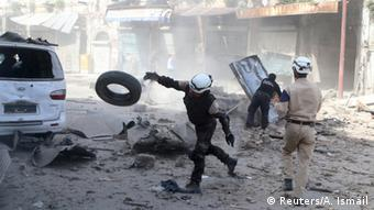 Civil defence members look for survivors after an airstrike on the rebel-held Old Aleppo.