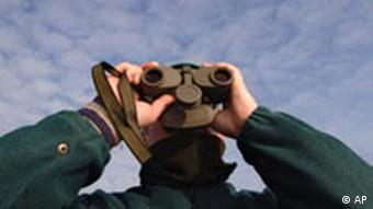 A person holding binoculars