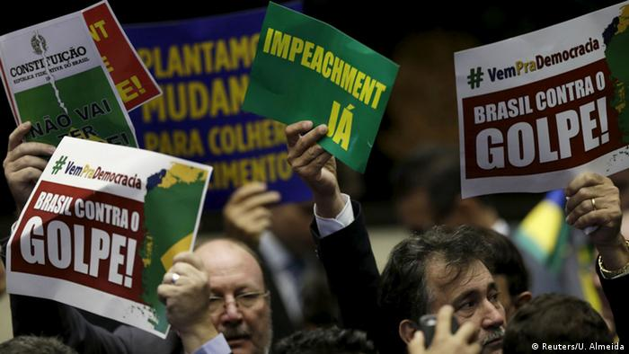 Brazilian lawmakers waving placards for and against Rousseff's impeachment