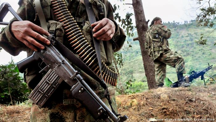 FARC rebels carrying weapons in the Colombian jungle
