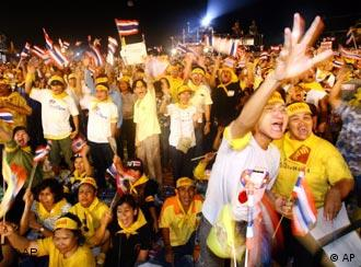 Thai protesters wave flags during a protest against Prime Minister Thaksin Shinawatra