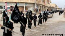 FILE - This undated file image posted on a militant website on Tuesday, Jan. 14, 2014, which has been verified and is consistent with other AP reporting, shows fighters from the al-Qaida linked Islamic State of Iraq and the Levant (ISIL), now called the Islamic State group, marching in Raqqa, Syria. More than a month after the slaying of Abdelqader and his friend Fares Hamadi, the media collective that Abdelqader belonged to _ which secretly documents life at the heart of the Islamic State¿s self-proclaimed caliphate _ has been forced into deep hiding. IS claimed responsibility for the murders in a video message warning that ¿every apostate will be slaughtered silently.¿ It was a grim riff on the media collective¿s name _ Raqqa is Being Slaughtered Silently, a reference to the Syrian city of Raqqa that has become synonymous with IS and its efforts to build a caliphate. (AP Photo/Militant Website, File)