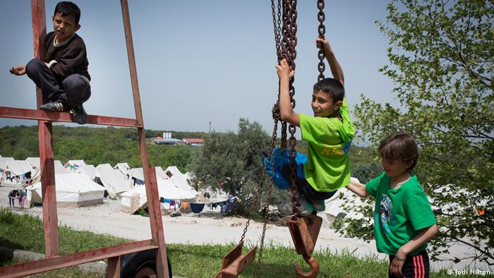 Children swing and climb on an industrial lift