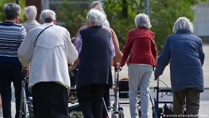 Group of older women with walkers
