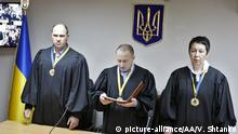 April 18, 2016. KIEV, UKRAINE - APRIL 18: Judge Nikolay Didyk (C) during a court hearing for Russian officers Yevgeny Yerofeyev and Alexander Alexandrov (not seen) at Holosiivskyi district court in Kiev on April 18, 2016. The court sentenced Yerofeyev and Aleksandrov to 14 years in prison to each. Yerofeyev and Alexandrov were captured in the East of Ukraine near the town of Schastye, Lugansk area,on 16 May 2015. Vladimir Shtanko / Anadolu Agency (c) picture-alliance/AA/V. Shtanko