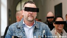 19.04.2016+++ Lutz Bachmann (L), co-founder of Patriotic Europeans Against the Islamisation of the West (PEGIDA), arrives with his wife Vicky at a courtroom for his trial to be charged with incitement over Facebook posts in a court in Dresden, Germany, April 19, 2016. +++ (C) Reuters/F. Bensch