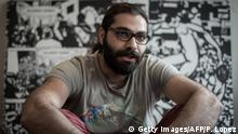 13.04.2016 *** TO GO WITH AFP STORY BY FIACHRA GIBBONS Syrian artist and cartoonist Hamid Sulaiman poses for a picture in Paris on April 13, 2016. Hamid Sulaiman lost his best friends to the Syrian goverment's torturers and secret police. Now his graphic novel about an underground hospital for wounded rebels is being acclaimed in France and Germany. / AFP / PHILIPPE LOPEZ (Photo credit should read PHILIPPE LOPEZ/AFP/Getty Images) © Getty Images/AFP/P. Lopez