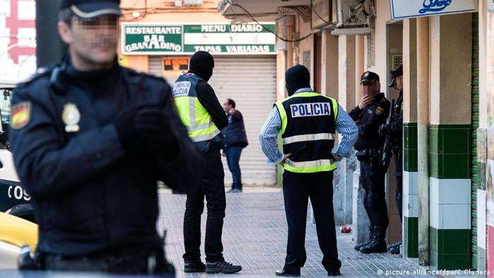 Police secure the flat of a man detained in relation to Islamic State (IS) in Palma de Majorca, Spain