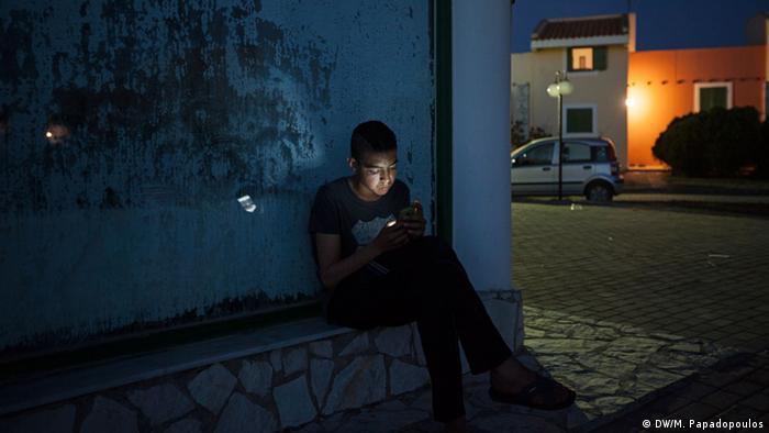 boy sitting in the dark