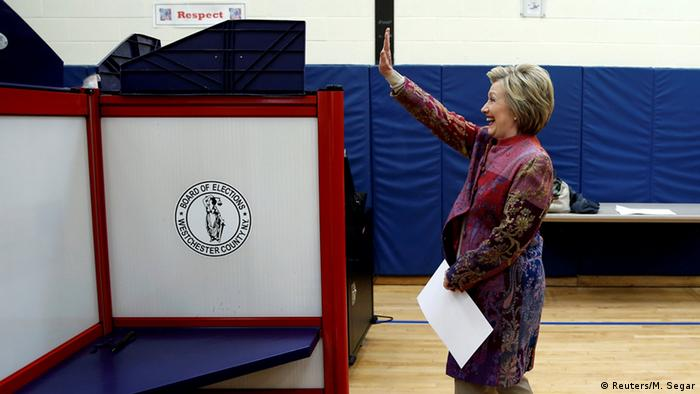 US democratic presidential candidate Hillary Clinton waves as she carries her ballot to vote in the New York presidential primary election at the Grafflin School in Chappaqua, New York.