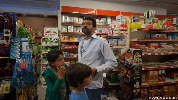 man and kids in a supermarket