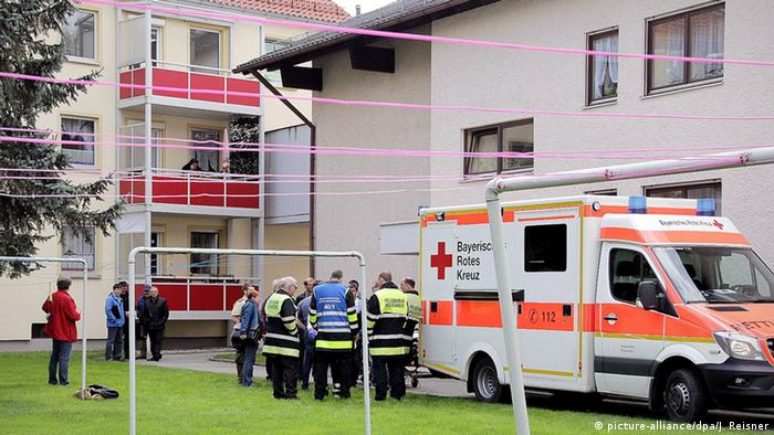 Emergency crews respond to an appartment in Rosenheim, Germany after a woman attempted suicide during an eviction and a captive woman was found