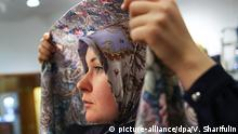 06.02.2016 *** MOSCOW, RUSSIA. FEBRUARY 6, 2015. A woman trying on a hijab in the Irada shop selling clothes for Muslim women, at the Nautilus shopping centre. Valery Sharifulin/TASS (c) picture-alliance/dpa/V. Sharifulin