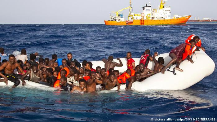 Migrants in the Mediterranean Sea on a sinking inflatable boat
