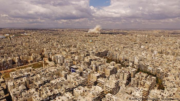 Smoke billowing over Aleppo after airstrikes on April 13