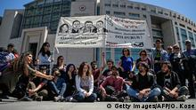 Supporters of four jailed Turkish academics gather in front of the Istanbul courthouse during their trial on April 22, 2016 in istanbul. F / AFP / OZAN KOSE Four Turkish academics go on trial Friday for 'terrorist propaganda' in the latest of a series of court cases that have highlighted growing restrictions on free speech under President Recep Tayyip Erdogan. / AFP / OZAN KOSE (Photo credit should read OZAN KOSE/AFP/Getty Images) Getty Images/AFP/O. Kose