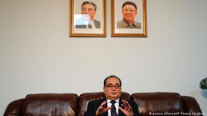 Seated under portraits of former North Korean Leaders Kim Il Sung, left, and Kim Jong Il, North Korea's Foreign Minister Ri Su Yong answers questions picture alliance/AP Photo/J. Jacobson