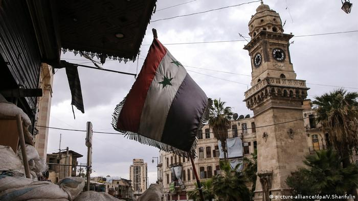 A Syrian flag in Aleppo's old town district