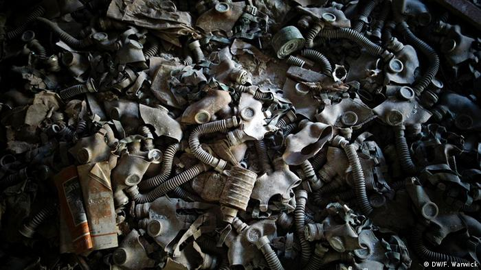 A floor covered in gas masks