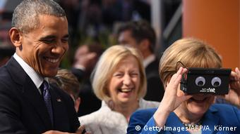 Angela Merkel wearing VR glasses with Barack Obama in Hanover, Germany, in 2016.