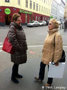 two women talking on a street copyright: Alison Langley