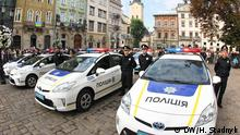 These photos about the Inauguration of the new police force in Lviv (Lemberg), Ukraine? The copyright is DW / Halyna Stadnyk.