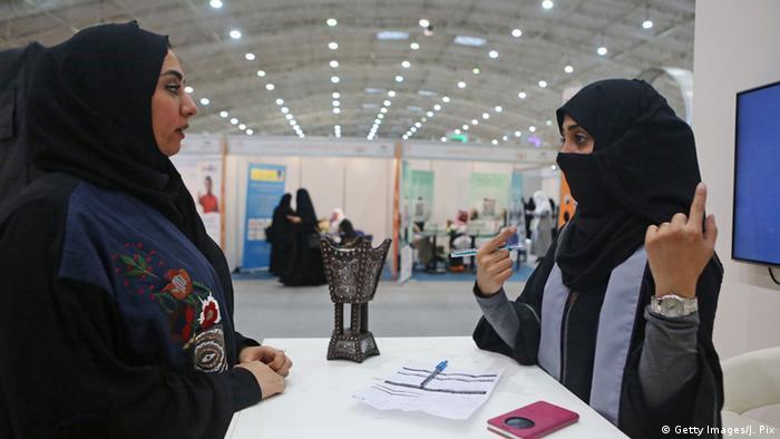 Two Saudi women at a job fair
