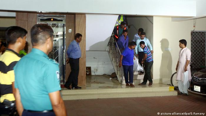 The body of Xulhaz Mannan is removed from his apartment