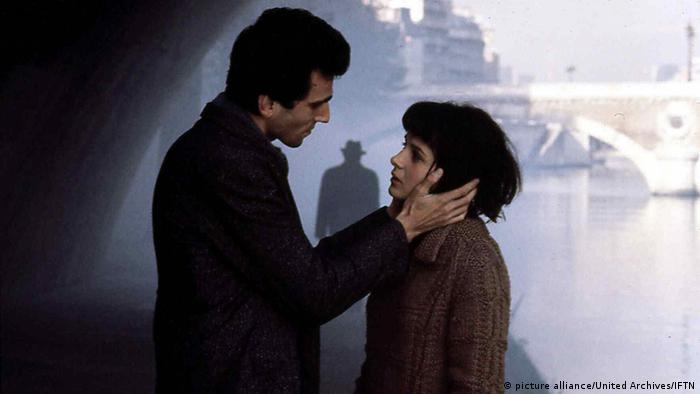 Film still from Unbearable Lightness of Being shows couple at the waterfront
