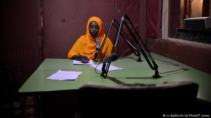 A female presenter reads into a microphone at Radio Shabelle