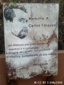 Panel showing text and portrait of Carlos Cardoso