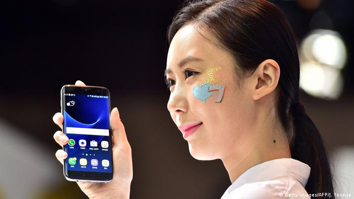Woman holds Samsung Galaxy S7