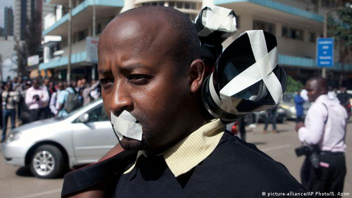 Protester with tape over his mouth