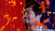 28.04.2016 Philipinen Filipino boxer Manny Pacquiao and Senatorial candidate for May 2016 is showered with confetti during election campaigning in San Pablo, Laguna in the Philippines April 28, 2016. Copyright: Reuters/E. De Castro