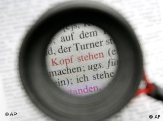 A magnifying glass highlights words in a German thesaurus
