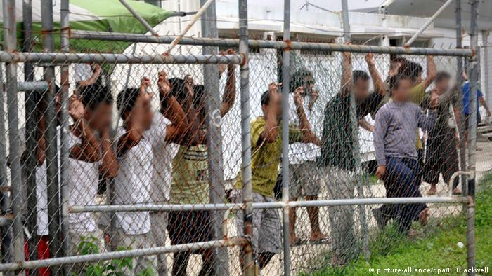 Manus Island detention center with refugees behind fence