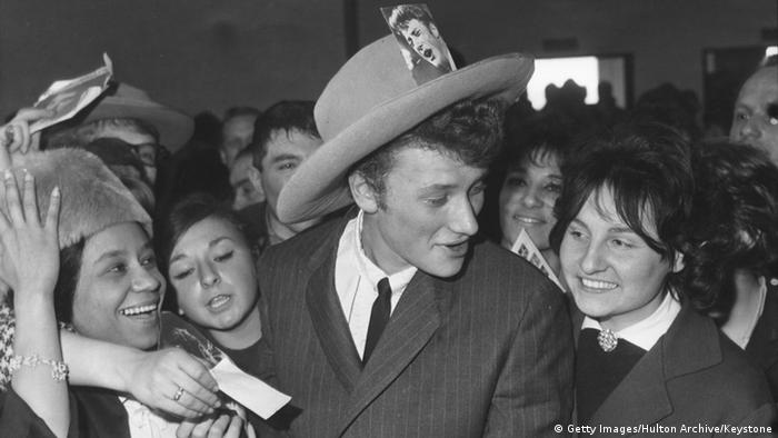 French singer and actor Johnny Hallyday surrounded by fans at Orly Airport in Paris, upon his return from a tour (Getty Images/Hulton Archive/Keystone)