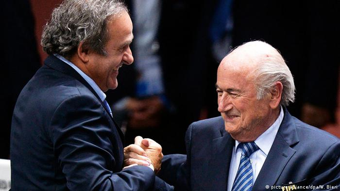 Michel Platini and Sepp Blatter celebrate Blatter being renamed FIFA president in 2015, soon before his rein would collapse. (picture-alliance/dpa/W. Bieri)