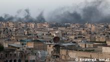 Smoke rises after airstrikes on the rebel-held al-Sakhour neighborhood of Aleppo, Syria.
