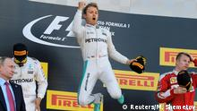 01.05.2016 *** Formula One - Russian Grand Prix - Sochi, Russia - 1/5/16 - Mercedes F1 driver Nico Rosberg of Germany (C) jumps on the podium as he celebrates victory during the Russian Grand Prix. REUTERS/Maxim Shemetov TPX IMAGES OF THE DAY © Reuters/M. Shemetov