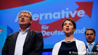 Frauke Petry, chairwoman of the anti-immigration party Alternative for Germany (AfD), and AfD leader Joerg Meuthen sing at the end of the second day of the AfD congress in Stuttgart, Germany, May 1, 2016. REUTERS/Wolfgang Rattay