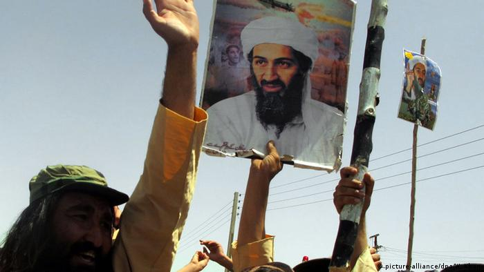 A placard with Osama bin Laden's image amid a protest in Pakistan