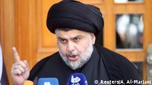 30.04.2016 ***** Prominent Iraqi Shi'ite cleric Moqtada al-Sadr speaks during news conference in Najaf, south of Baghdad, April 30, 2016. REUTERS/Alaa Al-Marjani © Reuters/A. Al-Marjani
