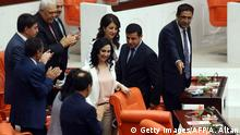 Co-presidents of People's Democratic Party (HDP) Selahattin Demirtas (2nd R) and Figen Yuksekdag (3rd R) are seen at the Grand National Assembly of Turkey during the Turkish parliaments first session after elections in Ankara, Turkey, on June 23, 2015. Turkey's parliament on June 23 opened for a new session after elections in which the ruling Justice and Development Party (AKP) lost its overall majority, with political parties working to thrash out the first coalition government in over a decade. +++ (C) Getty Images/AFP/A. Altan