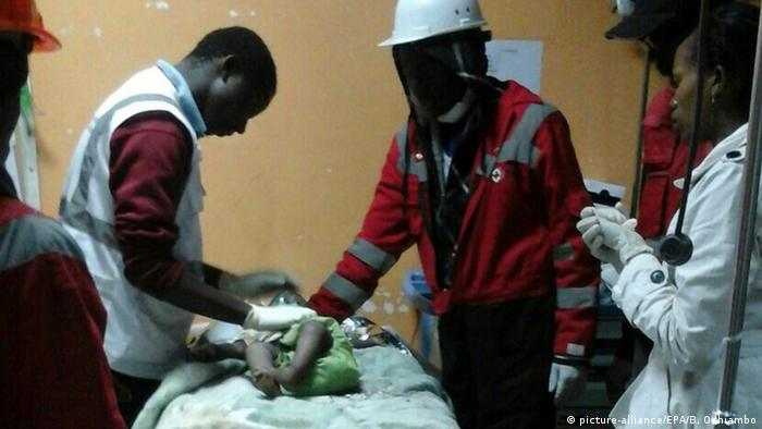 Medical staff in Kenya treat a baby girl who was rescued from a collapsed building in Nairobi