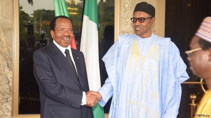 Nigerian President Muhammadu (left) greets Cameroonian President Paul Biya (left)