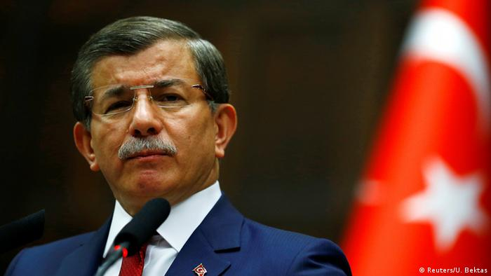 Turkey's Prime Minister Ahmet Davutoglu addresses members of parliament from his ruling AK Party (AKP) during a meeting at the Turkish parliament in Ankara, Turkey, May 3, 2016. REUTERS/Umit Bektas