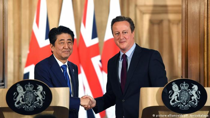 British Prime Minister David Cameron (R) meets his counterpart, Prime Minister of Japan, Shinzo Abe (L), during a press conference in N10 Downing street in London